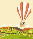 在一个热空气气球里面的动画片孩子 免版税图库摄影
