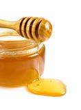 在一个玻璃瓶子的甜蜂蜜 免版税图库摄影