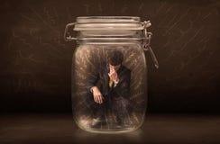 在一个瓶子里面的商人有强有力的手拉的线的概念 免版税库存照片