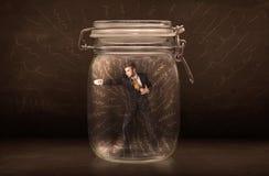 在一个瓶子里面的商人有强有力的手拉的线的概念 免版税图库摄影