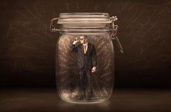 在一个瓶子里面的商人有强有力的手拉的线的概念 免版税库存图片