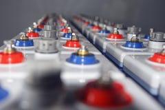 在一个电子驻地的一个强有力的电DC电池 免版税库存照片