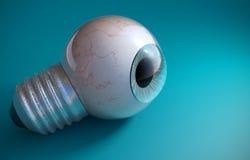 在一个电灯泡螺丝的蓝色眼珠 免版税图库摄影