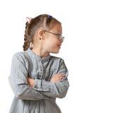 在一个白女孩的档案的画象玻璃和一件灰色礼服的 库存图片