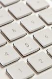 在一个白色和灰色键盘的数字键盘 库存照片
