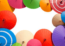 在一个白色背景用途的五颜六色的许多伞孤立框架的 库存照片