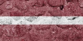 在一个石墙上的拉脱维亚旗子 库存例证