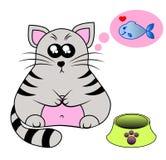 在一个碗后的一只逗人喜爱的微笑的小猫有鱼的 皇族释放例证