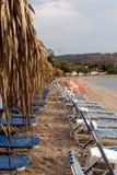 在一个离开的海滩的Sunbeds 库存图片
