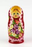 在一个空白背景的俄国玩偶 免版税库存照片