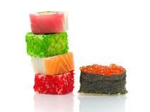 在一个空白背景的寿司和卷与反映 免版税库存照片