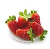 在一个空白背景的开胃明亮地红色草莓 库存照片