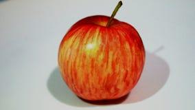 在一个空白背景的红色苹果 库存照片