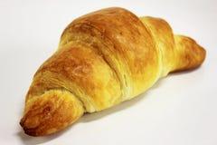在一个空白背景的黄油新月形面包 免版税图库摄影