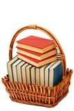 在一个篮子的书在被隔绝的白色背景 免版税图库摄影