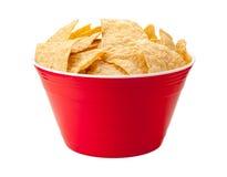 在一个红色碗的玉米片 免版税库存图片