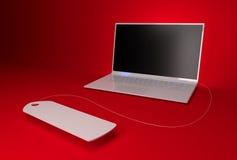 在一个红色背景的膝上型计算机 免版税库存照片