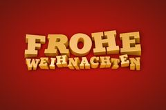 在一个红色背景的金黄Frohe Weihnachten文本 免版税库存图片