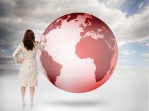 在一个红色行星的女实业家图画 免版税库存图片