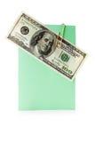 在一个纸夹附有的明信片的一百美元 库存图片