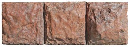 在一个老大厦的墙壁的三个红场花岗岩块 库存照片