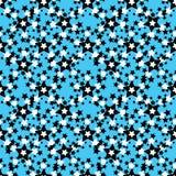 在一个蓝色背景无缝的样式的黑白星 图库摄影
