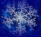 在一个蓝色背景的雪花 免版税库存图片