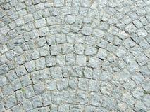 在一个被铺的正方形的石立方体 图库摄影