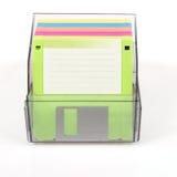 在一个透明箱子的色的磁盘 库存照片