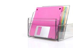 在一个透明箱子的色的磁盘 免版税库存照片