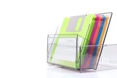 在一个透明箱子的色的磁盘 免版税库存图片