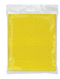 在一个透明装箱的黄色餐巾 免版税库存图片