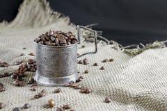 在一个银色杯座的咖啡 库存照片