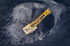 在一个露天开采矿的联合矿业 免版税图库摄影