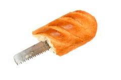 在一个面包掩藏的锯 免版税库存照片