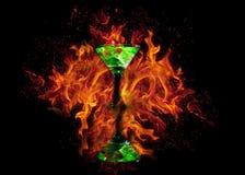 在一个鸡尾酒杯的红色模子在火背景 赌博娱乐场系列 图库摄影