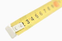 在一个黄色评定的磁带上的照相机重点 免版税图库摄影