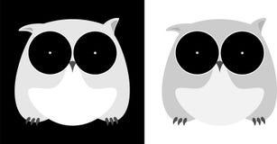 在一个黑暗的背景设计企业商标的Minimalistic猫头鹰 库存照片