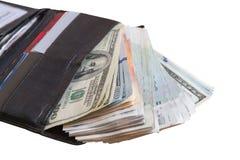 在一个黑皮革钱包的不同的票据,企业概念 拍卖费 免版税库存图片