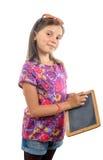 在一个黑板的小女孩文字有白垩的 免版税库存照片