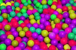 在一个水池的色的塑料球孩子的 图库摄影