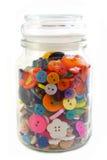 在一个玻璃瓶子的五颜六色的男子服饰用品按钮 在白色的垂直 免版税库存图片