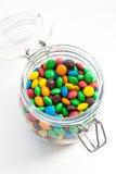在一个玻璃瓶子的色的糖果 库存照片