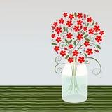 在一个玻璃瓶子的花 免版税库存照片