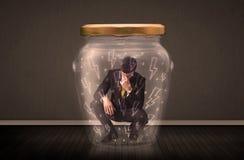 在一个玻璃瓶子里面的商人有闪电图画概念的 库存图片
