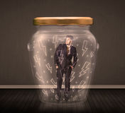 在一个玻璃瓶子里面的商人有闪电图画概念的 免版税图库摄影