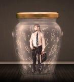 在一个玻璃瓶子里面的商人有闪电图画概念的 免版税库存照片