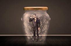 在一个玻璃瓶子里面的商人有闪电图画概念的 免版税库存图片