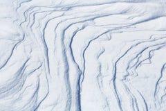 在一个冻Eagle湖的雪样式 免版税图库摄影