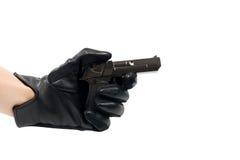 在一副黑手套的手与枪 免版税库存照片